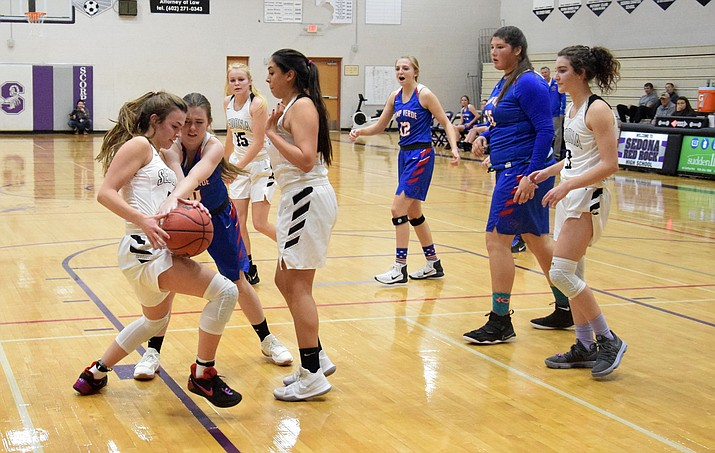 Camp Verde sophomore Anna Peterson goes for a steal during the Cowboys' 62-36 loss at No. 3 Sedona Red Rock on Tuesday night. The defeat was the Cowboys' first regular season one against a fellow 2A squad this year. (VVN/James Kelley)