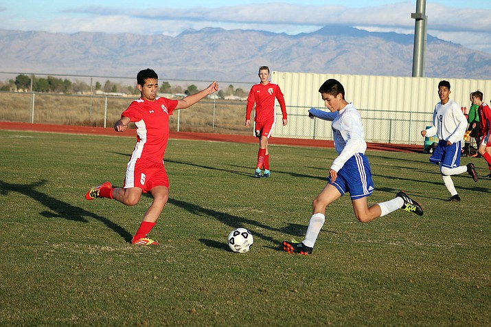 Kingman High's Alex Cardenas, right, battles for a ball against a River Valley defender Wednesday afternoon. The Bulldogs scored their lone goal of the game in the second half of a 11-1 loss.