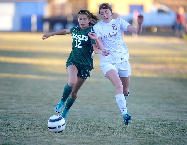 Prescott's Erika Smith (8) battles with Anna Harmon for possession as the Badgers take on Flagstaff on Thursday, Jan. 11, 2018, in Prescott. (Les Stukenberg/Courier)