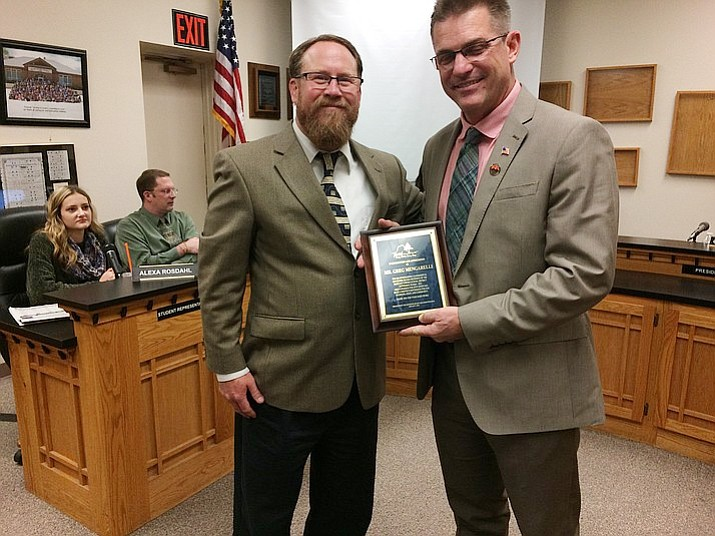 PUSD Governing Board President Greg Mengarelli receiving certificate of appreciation from Superintendent Joe Howard. Mengarelli, the new Prescott mayor, concluded his term as board president with election of officers on Tuesday night. (Nanci Hutson/Courier)