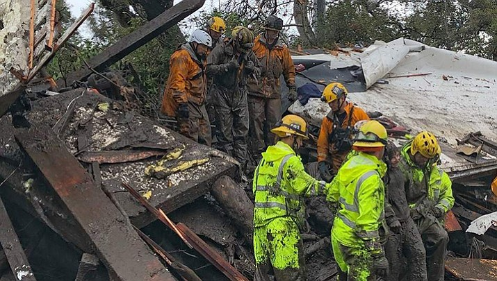 Emergency workers assist in the search and rescue of residents trapped by the mudslide in Montecito, California. (Santa Barbra Country Fire Department)