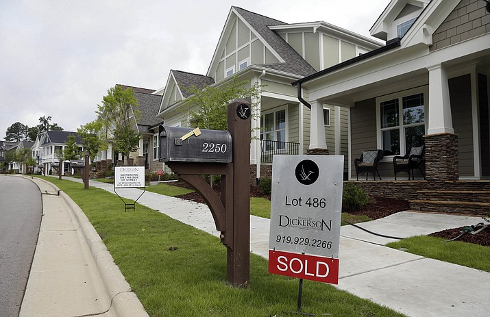"In this Tuesday, June 9, 2015, file photo, a ""Sold"" sign is displayed in the yard of a newly-constructed home in the Briar Chapel community in Chapel Hill, N.C. With just a few smart decisions, such as creating an emergency fund and getting an energy efficiency audit, you can get your homeownership off to a positive start. (Gerry Broome/AP, File)"
