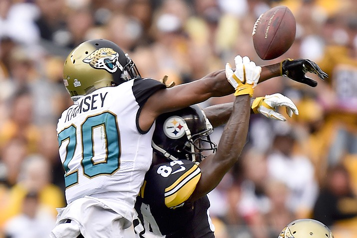 In this Oct. 8, 2017, file photo, Jacksonville Jaguars cornerback Jalen Ramsey (20) deflects a pass intended for Pittsburgh Steelers wide receiver Antonio Brown (84) in Pittsburgh. (Don Wright/AP, File)