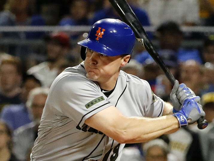 In this Sunday, May 28, 2017 file photo, New York Mets' Jay Bruce drives in two runs with a double off Pittsburgh Pirates starting pitcher Tyler Glasnow in the fifth inning in Pittsburgh. Two people familiar with the negotiations say free-agent outfielder Jay Bruce is set to return to the New York Mets after agreeing to a $39 million, three-year contract. (Gene J. Puskar/AP, File)