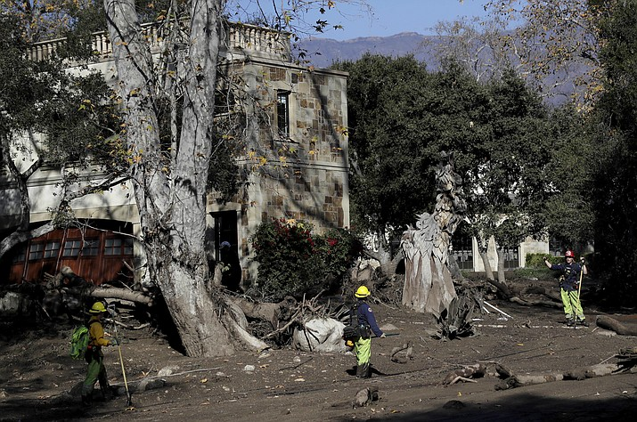 An emergency crew works near a home after storm damage in Montecito, Calif., Thursday, Jan. 11, 2018. Rescue workers slogged through knee-deep ooze and used long poles to probe for bodies Thursday as the search dragged on for victims of the mudslides that slammed this wealthy coastal town. (Marcio Jose Sanchez/AP)