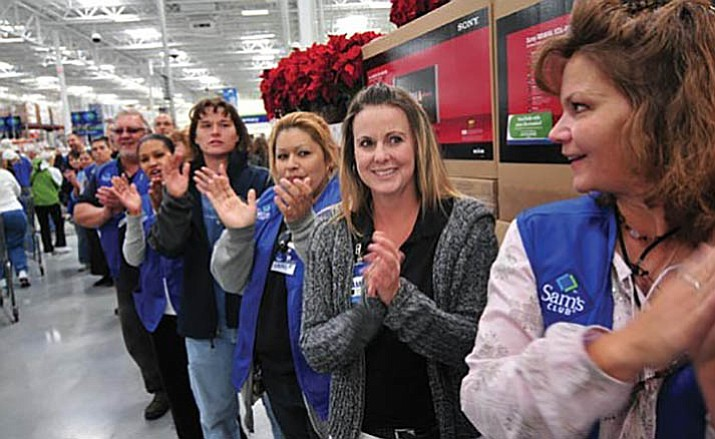 Associates at the Sam's Club in Prescott Valley welcome customers with applause during the grand opening in October 2008. Sam's Club is reportedly closing Jan. 26, 2018.