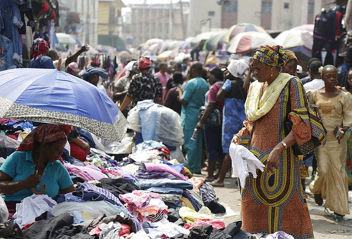 Pedestrians shop in a roadside market in Lagos, Nigeria. Africans were shocked on Friday to find President Donald Trump had finally taken an interest in their continent. But it wasn't what people had hoped for. (AP Photo/Sunday Alamba)