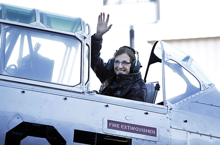 U.S. Rep. Martha McSally, R-Ariz., waves from a T-6 World War II airplane as she leaves for Phoenix, Friday in Tucson, Ariz. McSally announced Friday that she is running for the U.S. Senate seat being vacated by fellow Republican Jeff Flake. (AP Photo/Rick Scuteri)