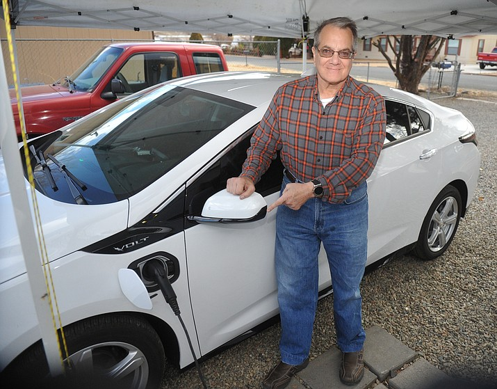 Richard Slatin, who owns a Chevy Volt, says that there are no power stations in Prescott Valley. Slatin suggests putting them at locations like the library. (Les Stukenberg/Courier)