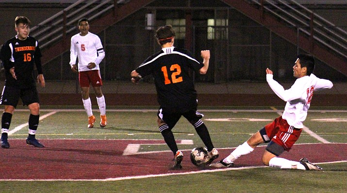 Mingus senior Issac Sanchez slides for the ball during the Marauders' 3-1 loss to Phoenix Thunderbird at home on Thursday night. (VVN/James Kelley)