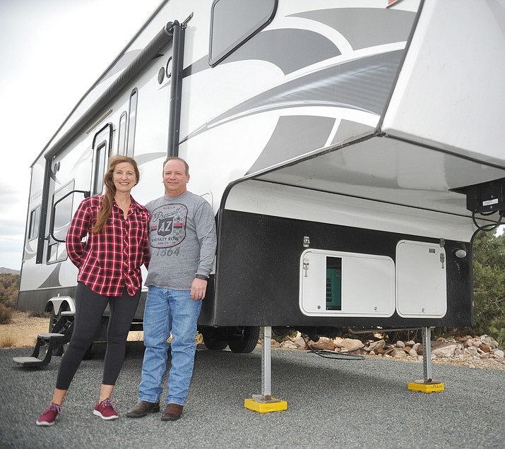 Mark Van Deusen and his wife, Patti, who plan to travel by fifth-wheel and plane now that he has retired from Quality Collision in Prescott Valley. (Les Stukenberg/Courier)