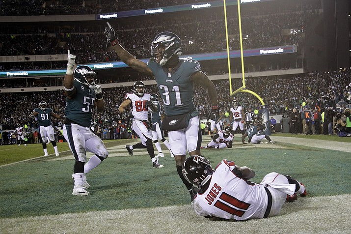 Philadelphia Eagles' Jalen Mills (31) and Brandon Graham (55) celebrate after Atlanta Falcons' Julio Jones (11) cannot catch a fourth down pass during the second half of an NFL divisional playoff football game, Saturday, Jan. 13, 2018, in Philadelphia. Philadelphia won 15-10. (Matt Rourke/AP)