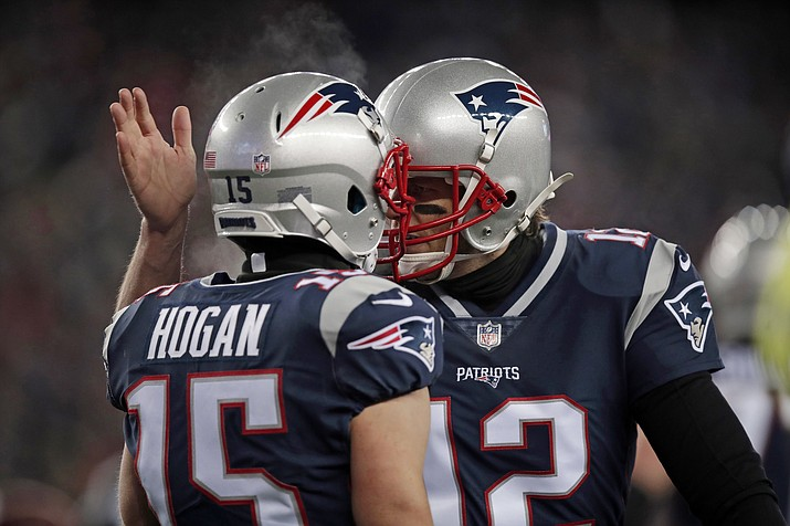 New England Patriots quarterback Tom Brady, right, celebrates his touchdown pass to Chris Hogan during the first half of an NFL divisional playoff football game against the Tennessee Titans, Saturday, Jan. 13, 2018, in Foxborough, Mass.