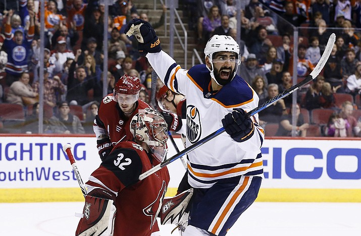 Edmonton Oilers left wing Jujhar Khaira, right, celebrates a goal by Oilers defenseman Darnell Nurse against Arizona Coyotes goaltender Antti Raanta (32) as Coyotes defenseman Oliver Ekman-Larsson (23) looks on during the first period Friday, Jan. 12, 2018, in Glendale. (Ross D. Franklin/AP)