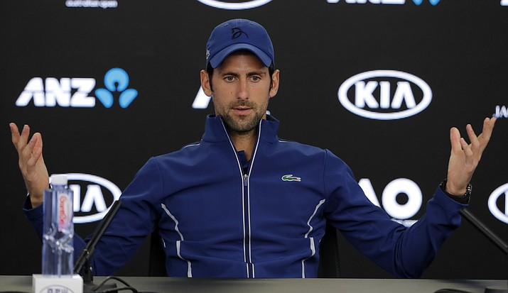 Novak Djokovic gestures during a press conference at the Australian Open tennis championships Saturday, Jan. 13, 2018. (Vincent Thian/AP)
