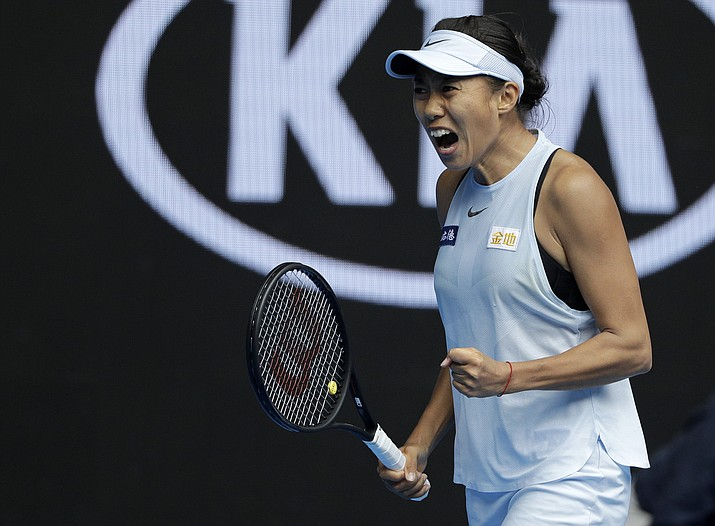 China's Zhang Shuai celebrates a point win over United States' Sloane Stephens during their first round match at the Australian Open tennis championships in Melbourne, Australia, Monday, Jan. 15, 2018. (Dita Alangkara/AP)