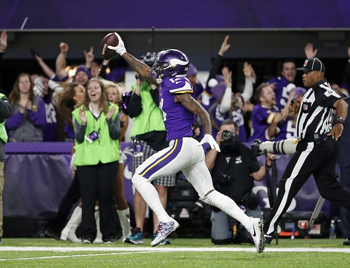 Minnesota Vikings wide receiver Stefon Diggs (14) runs in for a game winning touchdown against the New Orleans Saints during the second half of an NFL divisional football playoff game in Minneapolis, Sunday, Jan. 14, 2018. The Vikings defeated the Saints 29-24. (Jeff Roberson/AP)