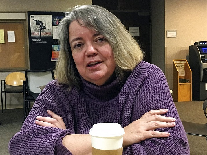 Victoria Steel, 50 of Cheyenne, Wyo. talks about President Trump and the media. Americans say they are increasingly confused and concerned about who can be trusted to tell them the truth about what's happening in Washington these days. Interviews and research from President Donald Trump's first year in office suggest Americans are scanning outlets for information about their government and their president. Steel says it's important for people to invest the time needed to find the truth about issues in the news rather than relying on sound bites and tweets. (AP Photo/Bob Moen)
