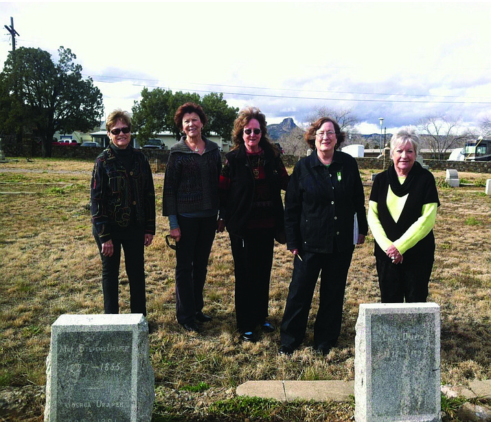 Members of the Prescott Pines Questers pose for a photo at the Draper plot.