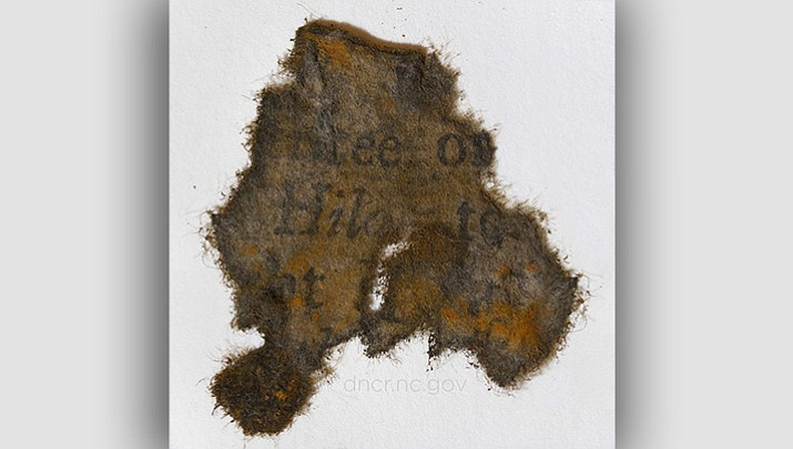 """Pictured is a piece of paper from books found on board Blackbeard's ship the Queen Anne's Revenge. To find paper in the 300-year-old shipwreck in warm waters is """"almost unheard of,"""" said Erik Farrell, a conservator at the QAR Conservation Lab in Greenville. (North Carolina Department of Natural and Cultural Resources via AP)"""