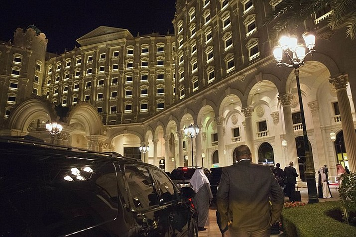 In this 2016 file photo, the motorcade carrying then U.S. Secretary of State John Kerry arrives at the Ritz Carlton Hotel in Riyadh, Saudi Arabia. The Ritz Carlton in Saudi Arabia's capital may be reopening its doors in times for Valentine's Day 2018 after serving as a prison for the country's elite caught up in what the government has described as a crackdown on corruption. (AP Photo/Jacquelyn Martin, Pool, File)