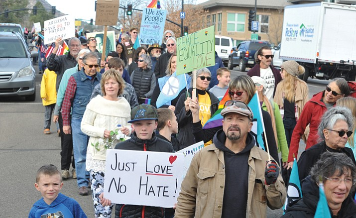 A crowd estimated, by the Prescott Police Department, at 450 people march in the annual Martin Luther King Jr. Peace and Justice March through downtown Prescott Monday morning.