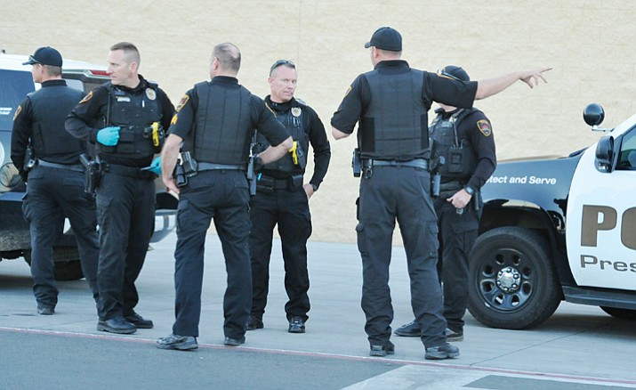 Members of the Prescott Valley Police Department talk strategy before entering the Walmart off Glassford Hill in Prescott Valley Monday, Jan. 15, 2018.