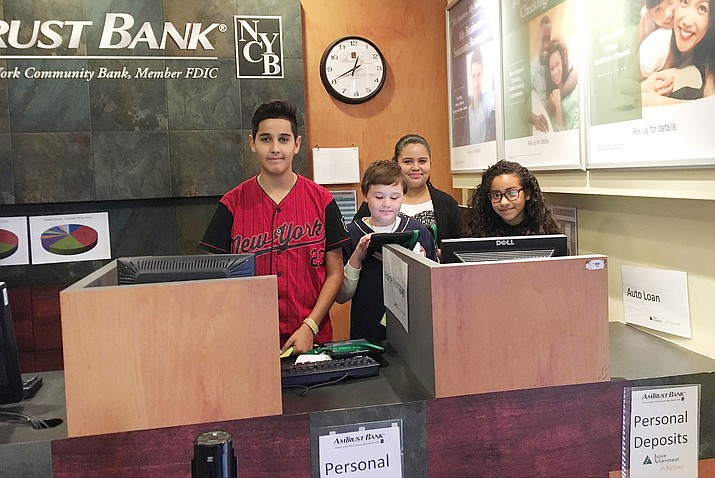 Beaver Creek School's seventh graders learn about banking at Biz Town in Tempe. Fort the past five years, Beaver Creek School has incorporated Biz Town into its social studies and economics programs. (Photo courtesy of Beaver Creek School District)