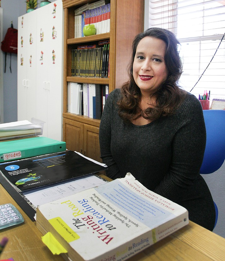 "Alicia Leon has been at Camp Verde's American Heritage Academy since the school opened 11 years ago. ""I feel honored to work for such an outstanding school,"" says Leon, who now teaches fourth grade after having served as a paraprofessional for the school. ""This school is very important to me. It not only teaches academics but how to be a person with integrity and to have respect for others."" (Photo by Bill Helm)"