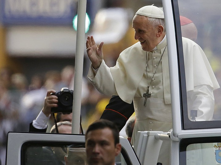 Pope Francis waves to followers on his way to the Apostolic Nunciature in Santiago, Chile, Monday, Jan. 15, 2018. (AP Photo/Natacha Pisarenko)