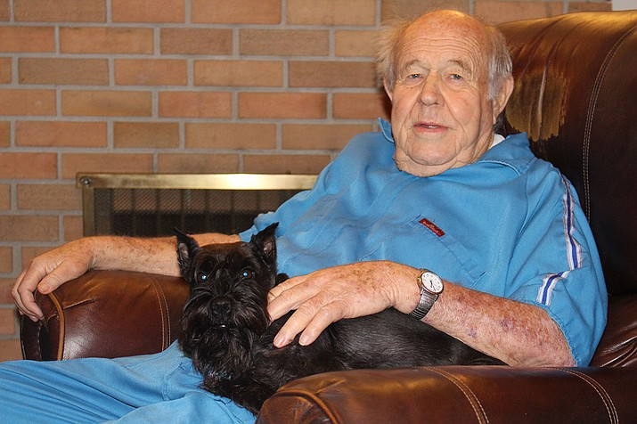 Eddie Pattillo, with his dog, Sally, is among the survivors of Mohave County Downwinders, a group of people who were exposed to low doses of radiation during testing of nuclear weapons in Nevada during the 1950s.