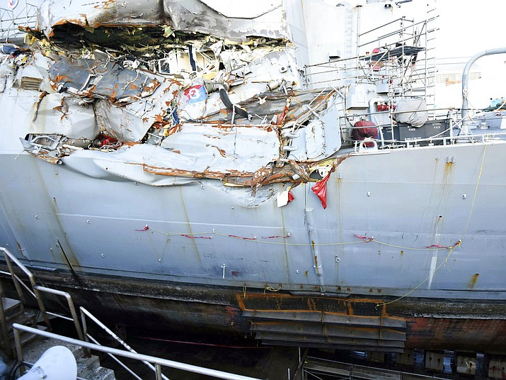 The USS Fitzgerald sits in dry dock in Yokosuka, Japan, to continue repairs and assess damage sustained from a June 17, 2017 collision with a cargo ship ran in the waters off of Japan. The Navy says it is filing negligent homicide charges against the commanders of two ships involved in fatal collisions last year. The charges are to be presented at what the military calls an Article 32 hearing, which will determine whether the accused are court martialed. (Spc. 1st Class Leonard Adams/U.S. Navy)