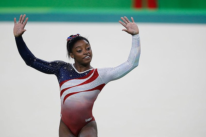 United States gymnast Simone Biles performs during the 2016 Summer Olympics in Rio de Janeiro, Brazil. In a statement via Twitter on Monday, Jan. 15, 2017, Biles says she is among the athletes sexually abused by a now-imprisoned former USA Gymnastics team doctor. (Photo by Agência Brasil Fotografias CC 2.0 license https://goo.gl/Lnniyj