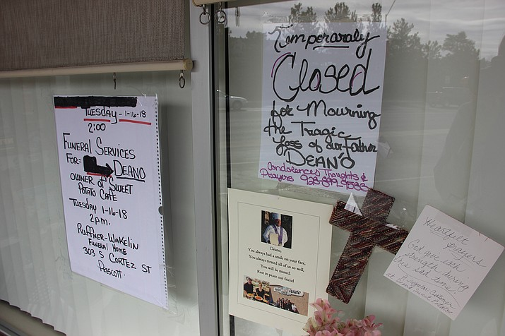 A number of signs were placed outside the entrance to Deano's Sweet Potato Café. The restaurant is temporarily closed following the death of its owner, James Dean Herbert II. (Max Efrein/Courier)