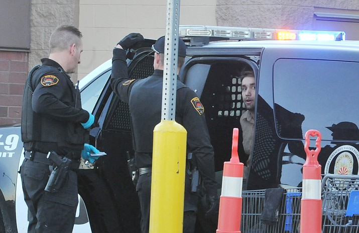 Prescott Valley Police arrest Matthew Solan outside of Walmart on Glassford Hill during a felony investigation Monday evening. (Les Stukenberg/Courier)