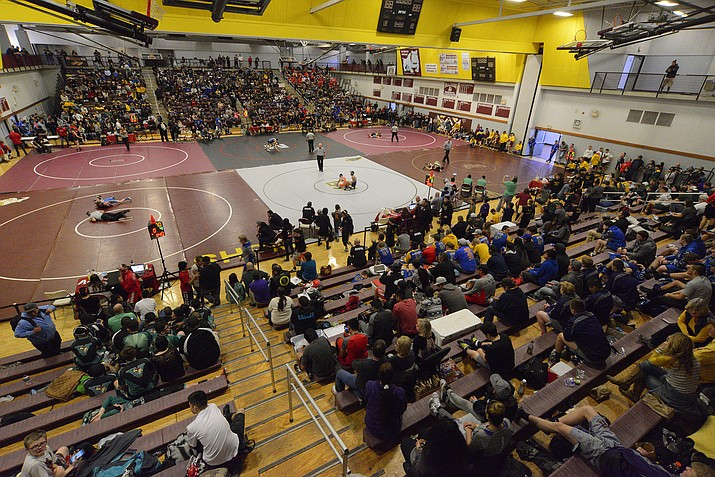 The two-day Doc Wright wrestling tournament was held at the Don Petranovich gym at Winslow High School Jan. 12-13. Forty-five high schools were represented, most from Arizona. Nevada, Colorado and Utah also were represented. In order to accommodate all of the schools, six wrestling mats held matches simultaneously. The illuminated electronic scoring stations were financed by local private donations, allowing Winslow High School to offer state-of-the-art efficiency for wrestling tournaments.