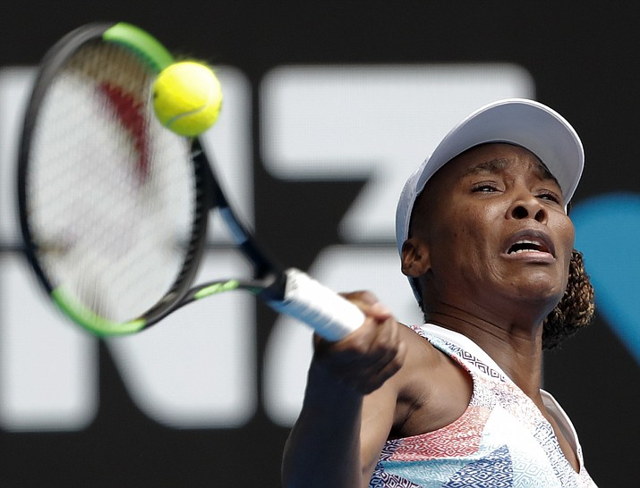 United States' Venus Williams makes a forehand return to Switzerland's Belinda Bencic during their first round match at the Australian Open on Monday, Jan. 15, 2018, in Melbourne, Australia. (Vincent Thian/AP)