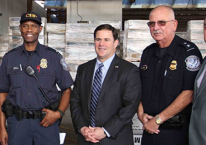 Arizona Governor Doug Ducey during a 2016 trip to the Mexico/U.S. border in Nogales, Arizona.