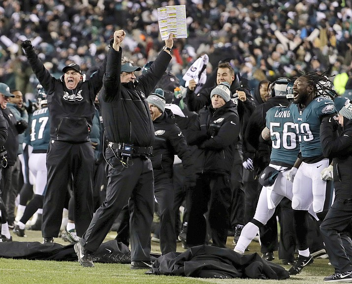 In this Saturday, Jan. 13, 2018, file photo, Philadelphia Eagles coach Doug Pederson, center, celebrates a defensive stop on fourth down in the second half of an NFL divisional playoff football game against the Atlanta Falcons in Philadelphia. The Eagles are home underdogs again in the NFC championship game against Case Keenum and the Minnesota Vikings. (Chris Szagola/AP, File)