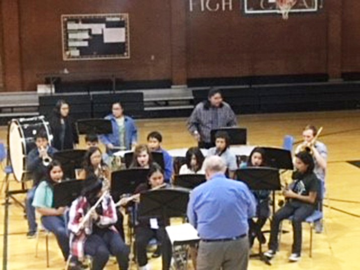 Tuba City Junior High School choir students get instruction from music teacher Morris Nesmith in their daily music lesson program.