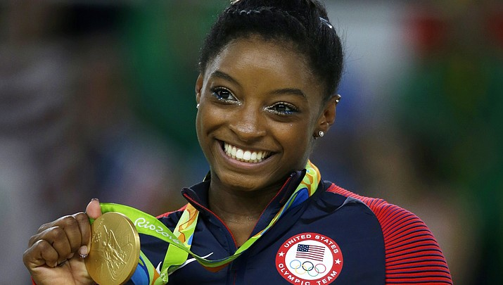 Olympic champ Biles says she was abused by team doctor