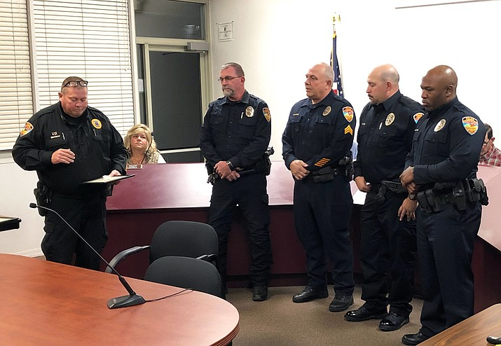 Williams Police Chief Herman Nixon honors officers Jerry Wilson, Tad Wygal, John Romero and Robert Anderson at a Williams city council meeting Jan. 11 for their actions while responding to an armed suicidal subject in November 2017.