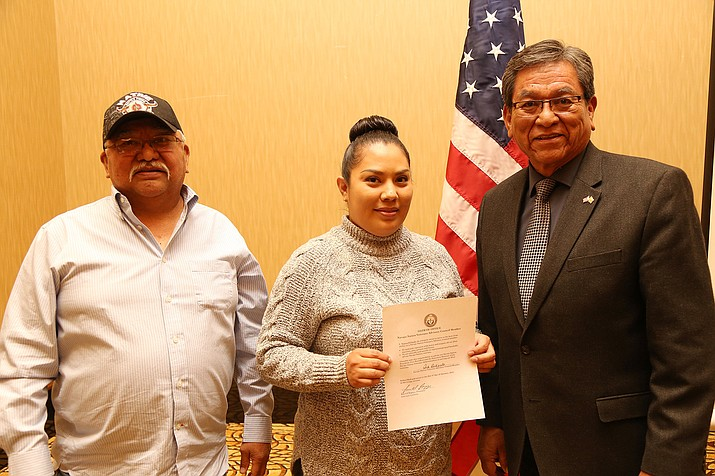 Vern Lee, chairman of the Veterans Advisory Council, and President Russell Begaye administer the oath of office for newly appointed member Tiarra DiNardo during a Jan. 4 ceremony.