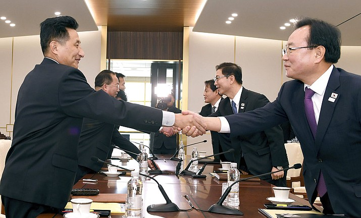 South Korean Vice Unification Minister Chun Hae-sung, center right, shakes hands with the head of North Korean delegation Jon Jong Su during their meeting at Panmunjom in the Demilitarized Zone in Paju, South Korea, Wednesday, Jan. 17, 2018. The two Koreas are meeting Wednesday for the third time in about 10 days to continue their discussions on Olympics cooperation, days ahead of talks with the IOC on North Korean participation in the upcoming Winter Games in the South. (South Korea Unification Ministry via AP)