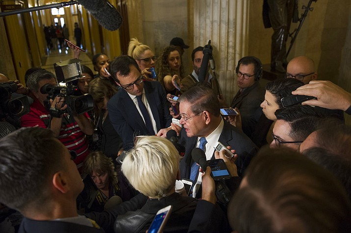 Sen. Robert Menedez, D-N.J., speaks with reporters after attending a Congressional Hispanic Caucus meeting with White House Chief of Staff John Kelly on Capitol Hill in Washington, Wednesday, Jan. 17, 2018. (AP Photo/Cliff Owen)