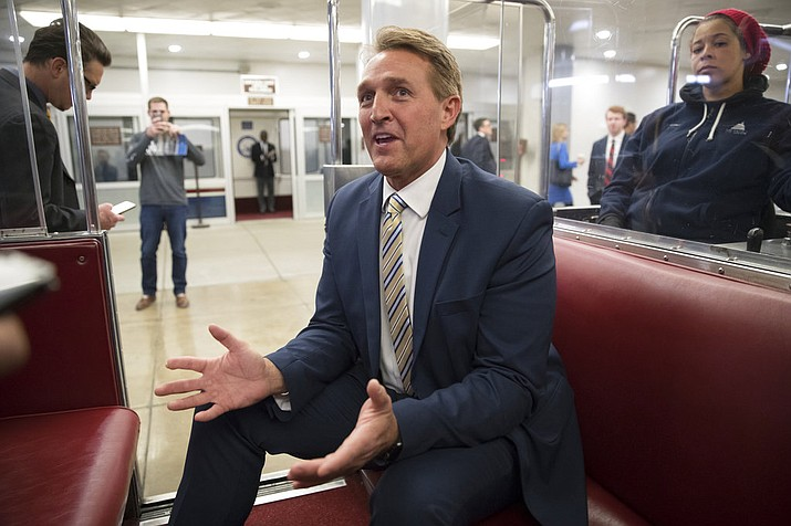 "Sen. Jeff Flake, R-Ariz., talks to reporters just after a blistering speech on the Senate floor aimed at President Donald Trump, at the Capitol in Washington, Wednesday, Jan. 17, 2018. In a speech on the Senate floor, Flake called Trump's repeated attacks on the media ""shameful"" and ""repulsive"" and said Trump ""has it precisely backward.'' Flake said despotism is the enemy of the people, while a free press is the despot's enemy and a guardian of democracy. (AP Photo/J. Scott Applewhite)"