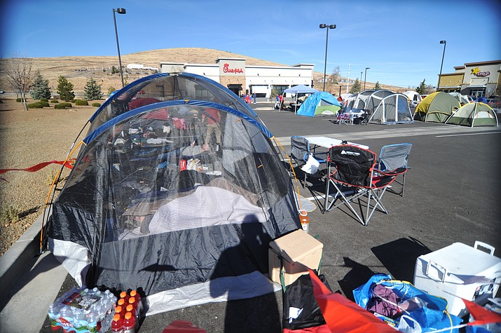 People started camping out early Wednesday in order to win a meal a week for a year at the new Chick Fil-A restaurant in Prescott Valley that opens Thursday morning. The first 100 people will win the prize and as of 11 a.m. Wednesday there were just under 50 people.  (Les Stukenberg/Courier)