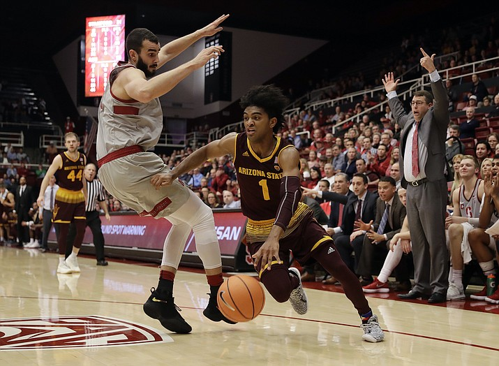 Arizona State guard Remy Martin (1) dribbles past Stanford center Josh Sharma, left, during the first half of an NCAA college basketball game Wednesday, Jan. 17, 2018, in Stanford, Calif. (Marcio Jose Sanchez/AP)