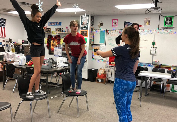 "Lee Williams High School students work on the choreography for ""Greased Lightning."""