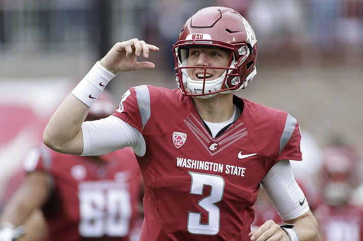 In this Sept. 17, 2016 file photo, Washington State quarterback Tyler Hilinski (3) runs onto the field with his teammates before game against Idaho in Pullman, Wash. Hilinski has died from an apparent self-inflicted gunshot wound. The 21-year-old Hilinski was discovered in his apartment after he didn't show up for practice Tuesday, Jan. 16, 2018. (Young Kwak/AP, File)